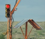 a solar panel powers an emergency stoplight in a construction zone