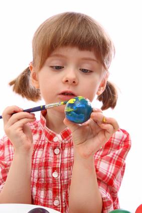 girl making fizzy Easter eggs