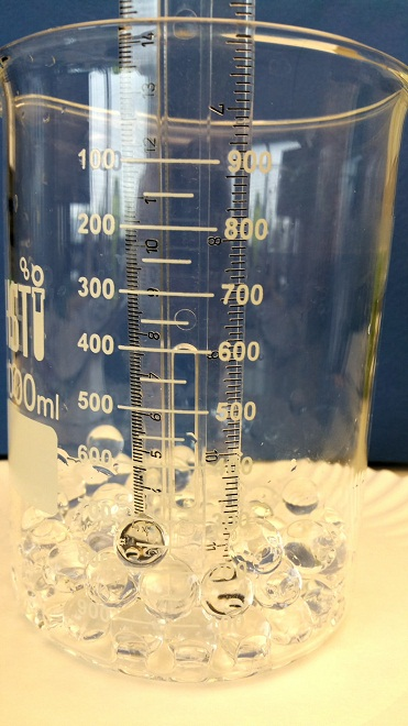 measure the hydrated water beads in the beaker